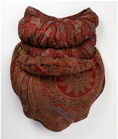 Bustle pad.  The bustle became common in the 1860s to create a more curvaceous figure.  Bustles were padded garments covered in fabrics including silk, cashmere, and cotton.