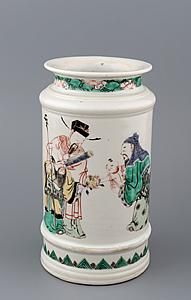 An albarello Porcelain famille verte, the cylindrical medicine jar with ribbed base and shoulders below a short waisted neck and wide flaring mouth, enamelled around the body with luxing watching Shouxing presenting a peach to a boy held by Fuxing, and on the reverse with a crane and a deer below five bats Height 19 cm China, Kangxi Period, circa 1662-1722 To be exhibited at #TEFAF2016 (11-20 March 2016) by Luis Alegria.