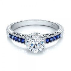 Diamond and Blue Sapphire Engagement Ring. I'd like it every other...diamond, sapphire... so on...