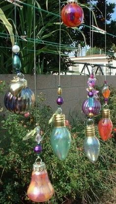 Recycled light bulbs & nail polish hung for garden art.
