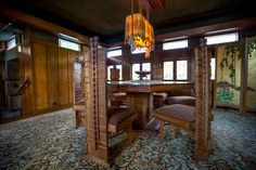 Frank Lloyd Wright's First LA House, Restored to Its 1920s' Beauty - Hollyhock House . . . The dining room has the original furniture including chairs that have spines like hollyhocks.