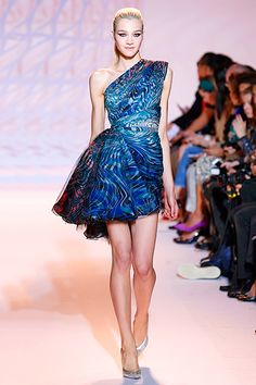 The 14 Most Stunning Dresses From Couture Fashion Week #refinery29  http://www.refinery29.com/fashion-week-dresses#slide6  Zuhair Murad Proof that a one doesn't need length for drama, Murad's '80s-inflected, side-gathered gown is the world's most perfect cocktail dress.