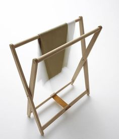 Freestanding towel rail in wood, teak, or white.