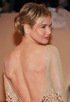Centered buns tend to make the face look rounder, warns Mitchell. But Renee Zellweger's side-swept bangs combined with height at the top of her head elongate her face, offsetting its roundness.