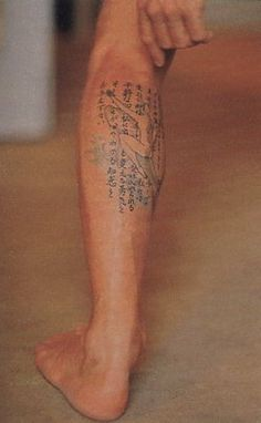 """David has one tattoo on the back of his left calf which depicts a dolphin and a Japanese variation of the Serenity prayer among the content, it portrays a man riding a dolphin with his left hand extended with a little frog, along with a personal Japanese (Kanji) inscription. David drew the artwork himself and had a Japanese tattooist ink it for him and also translate the prayer into Katakana. David says he had the tattoo done in 1991 """"as a confirmation of the love I feel for my wife and my…"""