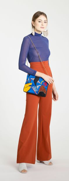 Lizzie Fortunato Shark Attack Safari Clutch, Erin Considine Raw Fringe Ridge Hoop, Zimmermann Arcadia Rust High Waist Pant, & Maryam Nassir Zadeh Off White Penelope Slide