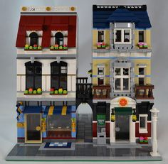 Jewelry Store and Pizzeria Inspired by 31026 Bike Shop. The medium blue and white building is the jewelry store, while the dark red and brown building is the pizzeria. Both have apartments on the upper floors. In the end I made this module a bike shop.
