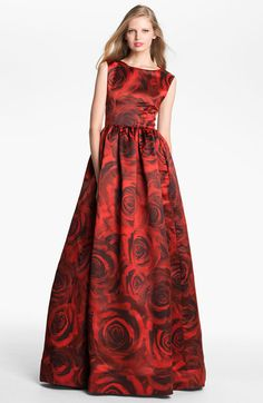 ALICE + OLIVIA Red Lano Rose Print Ball Gown. Voluminous skirt. The bateau neckline plunges to a V-back. Back zip closure. Sleeveless. Fully lined. Silk.