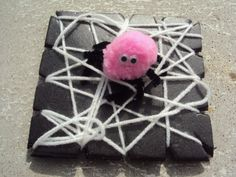 pom-pom spiders and wooly webs - happy hooligans - a halloween craft