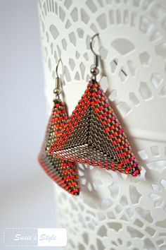 Dear Visitor, I am very glad that you like my own-made earrings I called Steel Pyramids.  Steel Pyramids are made of silver and ruby colored Miyuki