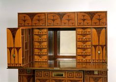 Koloman Moser Desk (has matching chair) / Vienna, Austria / 1903 / Veneered in thuya wood, inlaid with satinwood and brass, engraved and inked, on a deal carcase, with mahogany interior, oak drawer linings, other woods, including lime, spruce, alder, plane and elm, and gilt metal feet