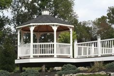 Vinyl Gazebo on corner of deck porch- We delivery fully assembled gazebos throughout eastern Ontario and Quebec. Visit us online for fully price list ncsshelters.com
