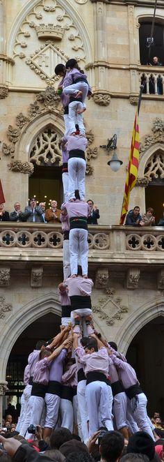 This festival is the tradition of building human towers dating back to the 18th century. A group of troupes that would compete in the building of human towers.