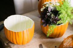 Faux pumpkins make great containers for flowers on a fall table! #repurposed