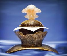 A $750 cupcake. The cupcake requires 48 hours advance notice, so it cannot be just an impulse purchase or a craving. Acclaimed Chef Olivier Dubreuil of the Venetian & Palazzo created the Decadence D'Or cupcake for Sweet Surrender at the Palazzo in Vegas. This $750 cupcake is made from Venezuela's rare Porcelana Criollo Chocolate, topped w/ Tahitian Gold Vanilla Caviar & edible gold flakes (Yes, real gold), Louis XIII de Remy Martin Cognac, w/ a hand blown sugar Fleur-de-Lis.