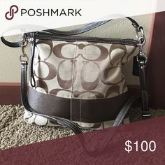 Coach Shoulder or Crossbody Bag This bag is great for everyday use or traveling. It is canvas with brown. Coach Bags Crossbody Bags