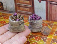 Potatoes in a bag. Miniature Potatoes. Miniature vegetables