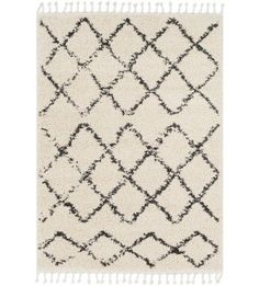 Give your room a bohemian-chic look with this Moroccan-inspired rug's geometric pattern and fringed edges. Obsess over the free-spirited look and indulge in the plush shag texture. #RugsTexture