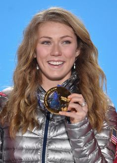 DAY 15:  Gold medalist Mikaela Shiffrin of the United States celebrates during the medal ceremony for the Alpine Skiing Women's Slalom http://sports.yahoo.com/olympics