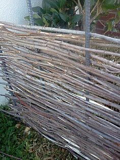 My wattle fence is looking good!  Next I need to cap it.  I found these super cool rebar caps but they're bright yellow-paint and a 2x4 will finish the top! Outdoor Life, Outdoor Spaces, Outdoor Gardens, Outdoor Decor, Farm Fence, Rustic Fence, Wattle Fence, Willow Fence, Garden Gates And Fencing