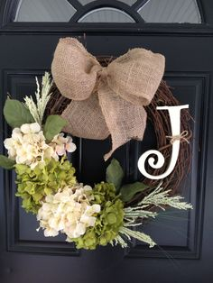 Handmade, personalized initial grapevine wreath with burlap bow and hydrangea flowers.