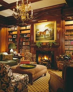 Love these bookshelves and all these warm colors - greens, reds, golds!