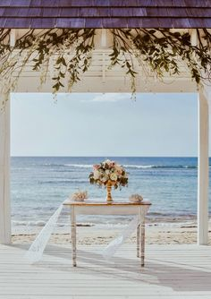 Lover the flower arrangement and vase as well as the flying lace table runner Hanging Orchid, Montana Wedding, Lace Table Runners, Save The Date Photos, Beach Resorts, Puerto Rico, Flower Arrangements, Orchids, Gazebo