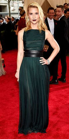 The Most Jaw-Dropping Dresses at the 2015 Met Gala | CLAIRE DANES | in a deep forest gown with wrapped chiffon and a leather belt, deep wine lips and Fred Leighton Art Deco jewels.