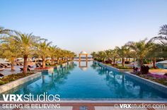 The picturesque view from the #pool at the #Hilton Ras Al Khaimah Resort and Spa evokes the feeling of serenity and relaxation. View more stunning photography here: http://www.vrxstudios.com