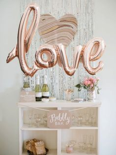 The perfect statement piece for your next celebration. These 40 rose gold mylar balloon is easily strung and hung for your next party! (Looks great for a photo/ backdrop pictures!)   ----------------------------------------------------------------------------------------  Each set includes:  -40 connected script letters {4 letters: L-O-V-E}   ----------------------------------------------------------------------------------------  Balloons are easily filled with AIR (not helium) and may be…