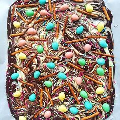 Chocolate Easter Bark With Pretzels And Chocolate Candy Eggs. Get this and 50+ more Easter recipes at https://feedfeed.info/easter