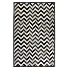 Bring a luxe touch to your foyer, living room, or master suite with this handsome handcrafted cowhide rug.   Product: RugC...