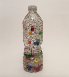 Alphabet Sensory Bottle: empty and clean plastic water or soda bottle with labelling removed, corn syrup, water, A-Z craft beads, glitter, sequins and a glue gun  See how to here: http://harmonylearning.com.au/10-craft-projects-for-pre-kindy-kids/