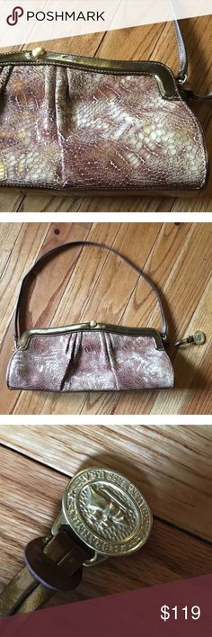 "Brahmin Small Snakeskin Purse Handbag Gorgeous brown snakeskin bag from Brahmin Strap is detachable to use a as a clutch if needed Beautiful interior with one inner pocket There is a small lipstick smudge on the interior, shown in pics. I have not tried to remove it as I am afraid to mess up the fabric. Only carried a few times. Measurements  13 x 6 x 2 Strap length 24"" total Brahmin Bags Shoulder Bags"