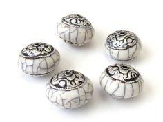 Rondelle white crackle resin capped tibetan beads. $7.99, via Etsy.