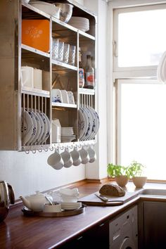 Kitchen storage - Contemporary plate rack with storage for the beautiful table ware. Use hooks to hang the fine cups.