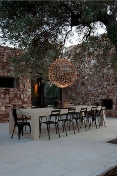 How fabulous is this suspended fairy-light globe chandelier! The space just woul. Outdoor Rooms, Outdoor Dining, Outdoor Gardens, Outdoor Decor, Exterior Design, Interior And Exterior, Landscaping With Fountains, Globe Chandelier, Stone Houses