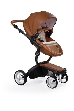Mima Xari - Camel Seat, Sandy Beige Starter Pack | The only stroller made with leatherette fabric, the Mima Xari is more than a pretty face. With a chic design and advanced features, this highly-customizable stroller strikes the perfect balance of fashion and functionality.