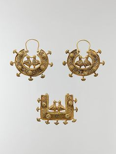 Earrings and Pendant.11-12th century. Iran. Islamic.constructed of gold sheet, wire, and filigree; the details of the decoration, including the two confronted birds joined by their beaks, were achieved with openwork filigree and fine granulation.