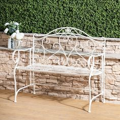 Add to your garden the classic elegance and style of a traditional English garden, with the Venice Wrought Iron Garden Bench. With scrolling hearts and an intricate metalwork design, this beautiful garden bench will set the scene for many romantic and hea Classic Elegance, Porch Swing, Outdoor Furniture, Outdoor Decor, Garden Bridge, Wrought Iron, Beautiful Gardens, Venice, Outdoor Structures