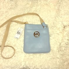 MK Cross Body Bag-- Pale Blue Pale Blue MK bag. Leather, cross body with adjustable strap. Brand new with tags!! The MK logo has a couple of itsy tiny scratches . NO TRADES. Reasonable offers are welcomed.                  Ships within 24-48 hrs Michael Kors Bags Crossbody Bags