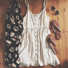 gorgeous floral black loose pant, cute white loose buttons blouse, heart black goggles, and brown ladies shoes. perfect summer outfit!