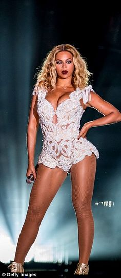 Beyonce shows off her curves in a fitted, embellished playsuit in one of her stunning live shows