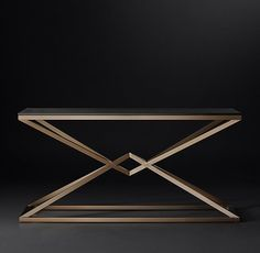 RH Modern's Empire Console Table:A dynamic double pyramid is the striking centerpiece of our 1970s-inspired table. An interpretation of a classic X-brace design, its tubular metal base supports a clear glass top that shows off its distinctive geometric form.