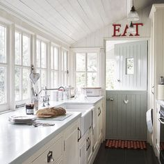 """I like the """"EAT"""" thing. Nice contrast and adds some fun to an otherwise serene kitchen."""