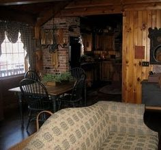 So cozy and warm looking. Love the wood on the wall.