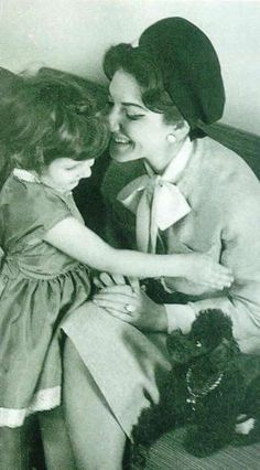 A tender moment captured between Maria Callas and young fan