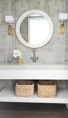 Kelly Wearstler Crescent wallpaper and West Elm parsons round bone inlay mirror