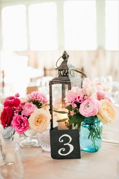 I don't know if it works for this party or not, but I like the idea of a chalkboard table number (but not the rest if this centerpiece). If we used candy jars it could be a large chalkboard label even