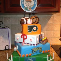 Sports cake would be cute with Boston teams for Ry. Patriots, Celtics, Red Sox and Bruines